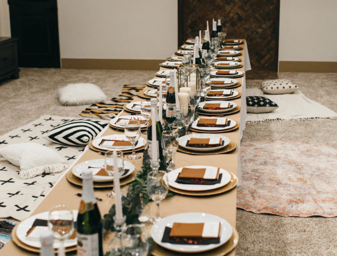 the perfect friendsgiving decorations on a budget with catered olive garden // floor seating for a nice girl's dinner