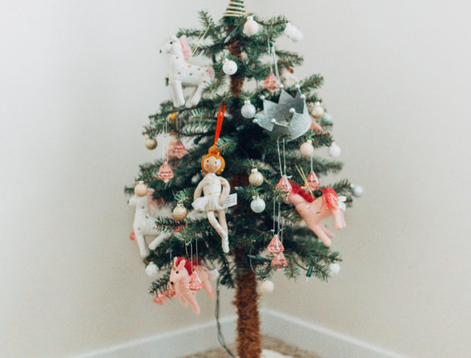 the cutest, affordable christmas tree decorations for kids / little girl's christmas tree for kid's room with pink and gold accents
