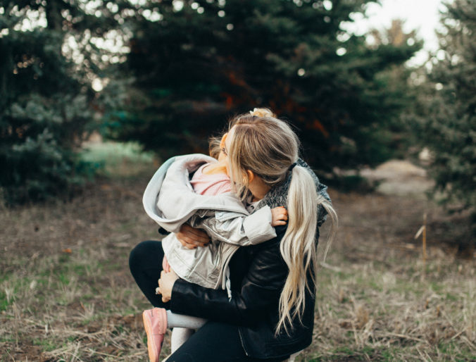 Cute Mommy Daughter moments in matching jackets Christmas Tree pictures