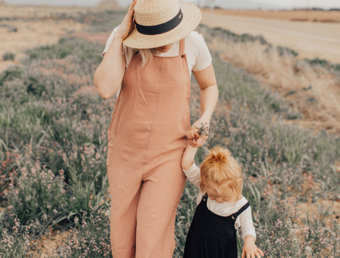 modern style for a mom on the go with zappos new shoes, naot sandals / pink romper jumper and flower field pictures mother daughter