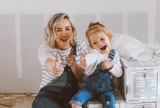 A cute DIY mommy and me photo working on the house together for the lowe's upskill contest