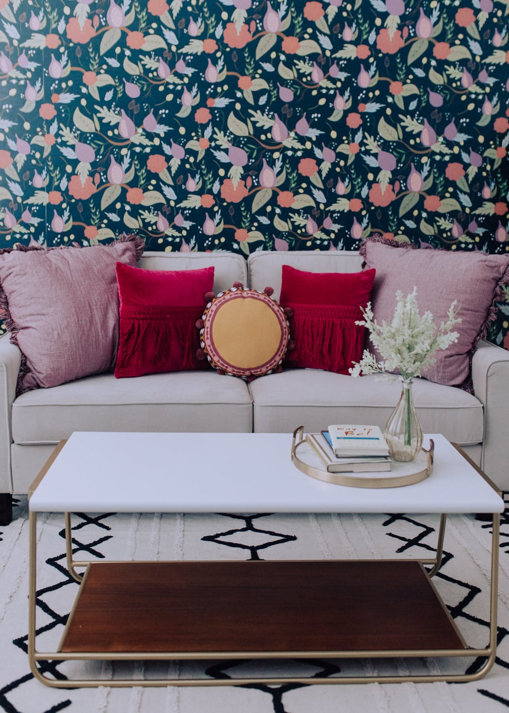 vibrant bohemian vibe with simple white touches and gold accents with pink office / office decor that is modern with a boho twist and organized / long desk and shelving unit