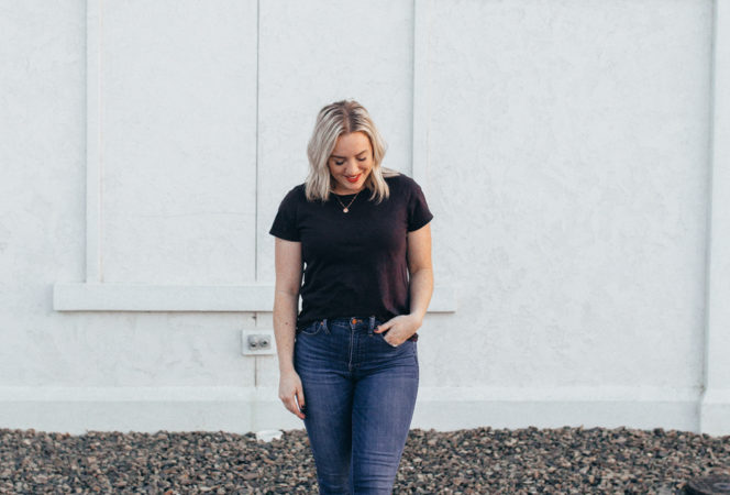 ways to style a basic t-shirt with jeans , high waisted jeans and a basic black tee with cuffed sleeves and front tucked in for a cute mom style on the go relaxed look for fall or summer