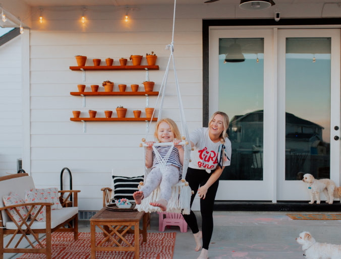 Making a home on our patio, easy to install cafe lights and landscape lights that color change and you can control from a remote all featured on a white, modern farmhouse patio. @EnbrightenBrand #ColorChangesEverything #ad