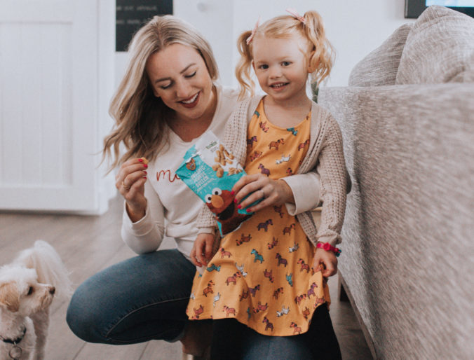 favorite toddler/kids snack and quick ways to be more organized on the go / plus a cute toddler zebra dress and style with curly pigtails hair style