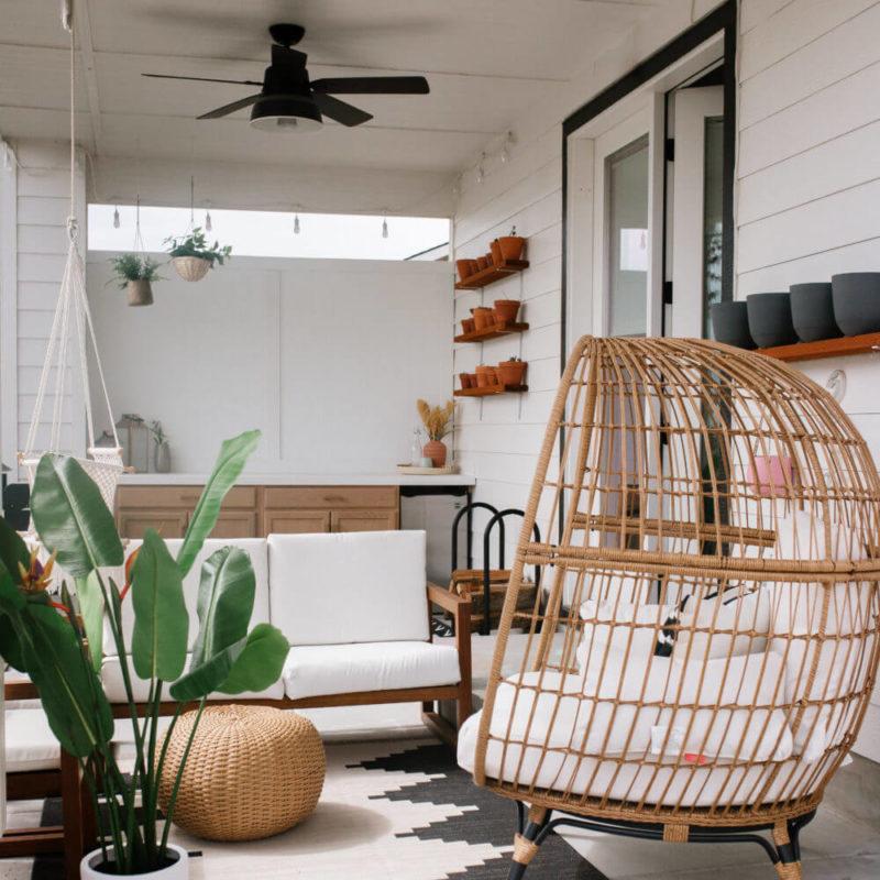 boho desert feel patio area with egg chair and DIY bar kitchen area // bohemian outdoor sitting area patio idea