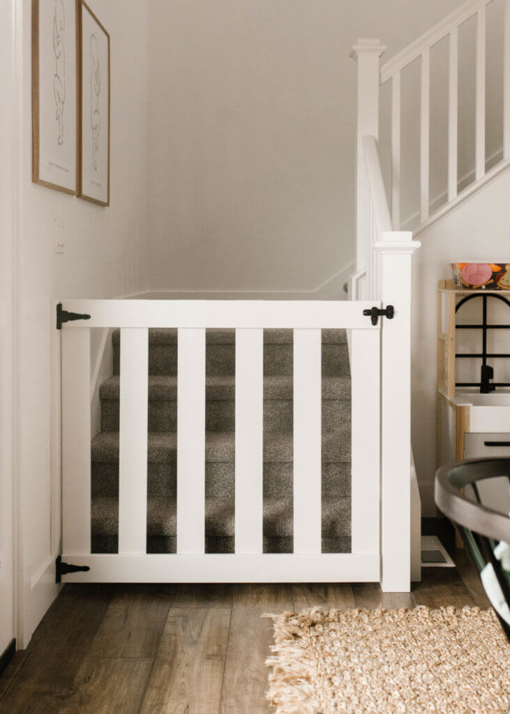diy wooden baby gate tutorial / easy baby gate tutorial for under $40 / white modern baby gate with black hardware