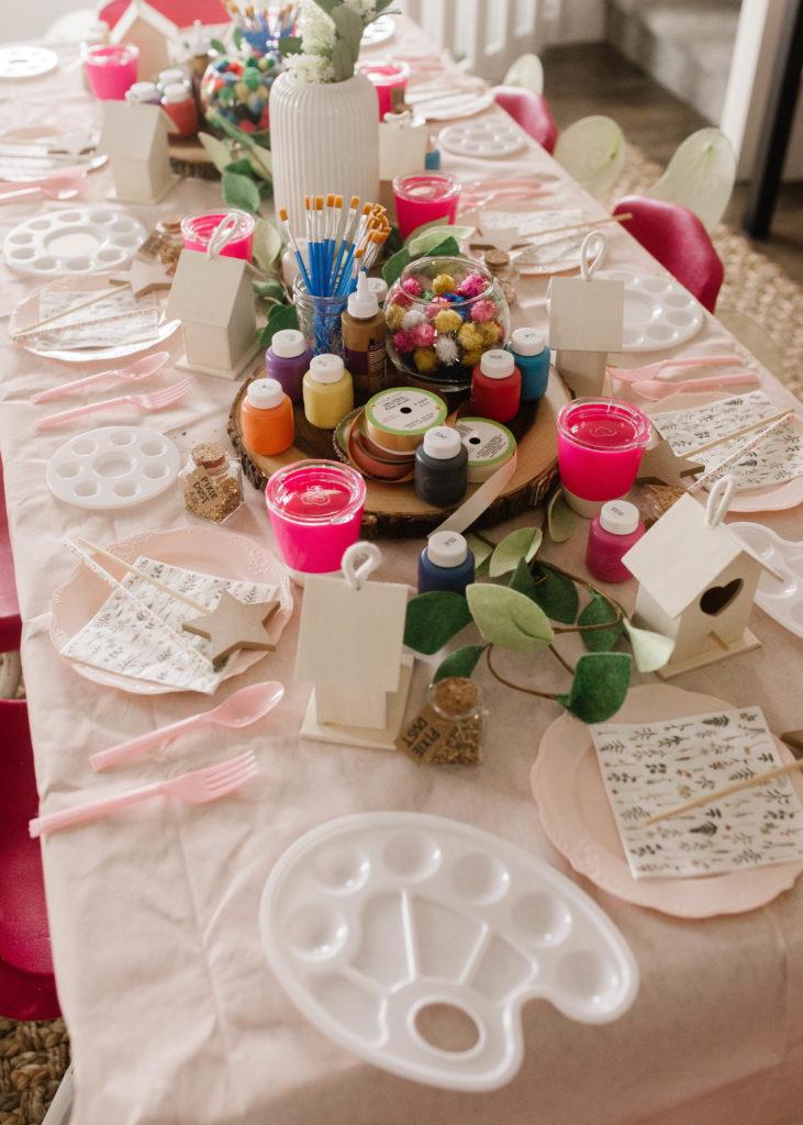 fairy garden boho birthday party with peach balloon garland