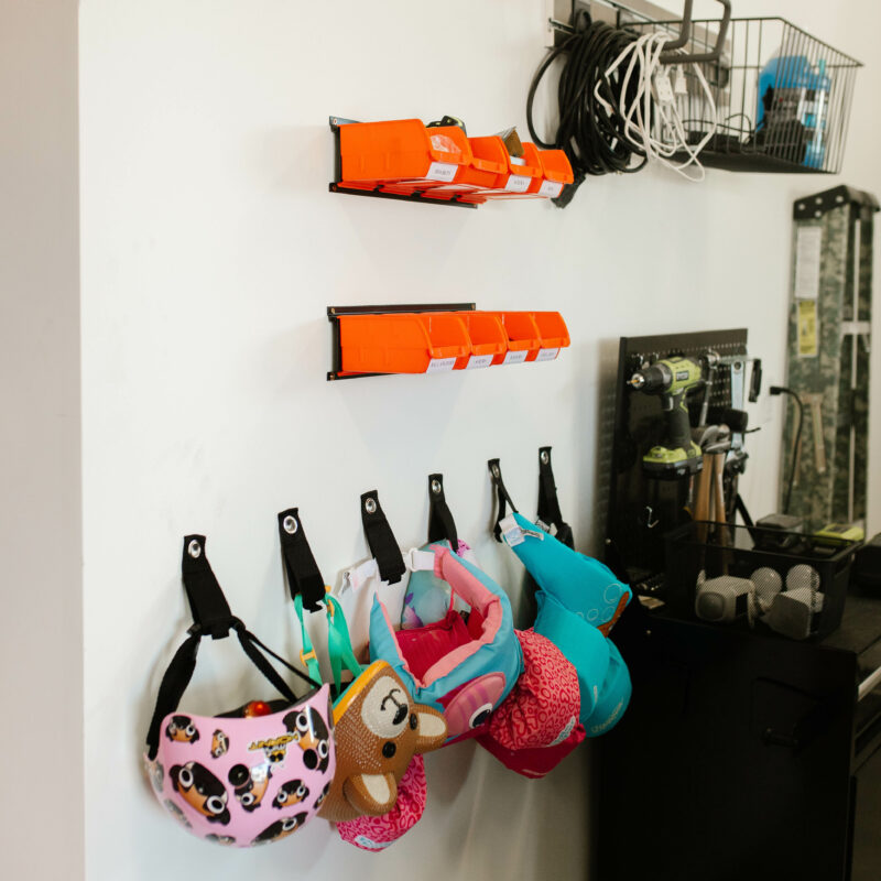 ultimate garage organization on a budget / DIY and easy to do / bike storage/ food storage / bin storage / how to organize your garage // overhead bin storage / painted garage walls // how to make your garage functional // jess oakes