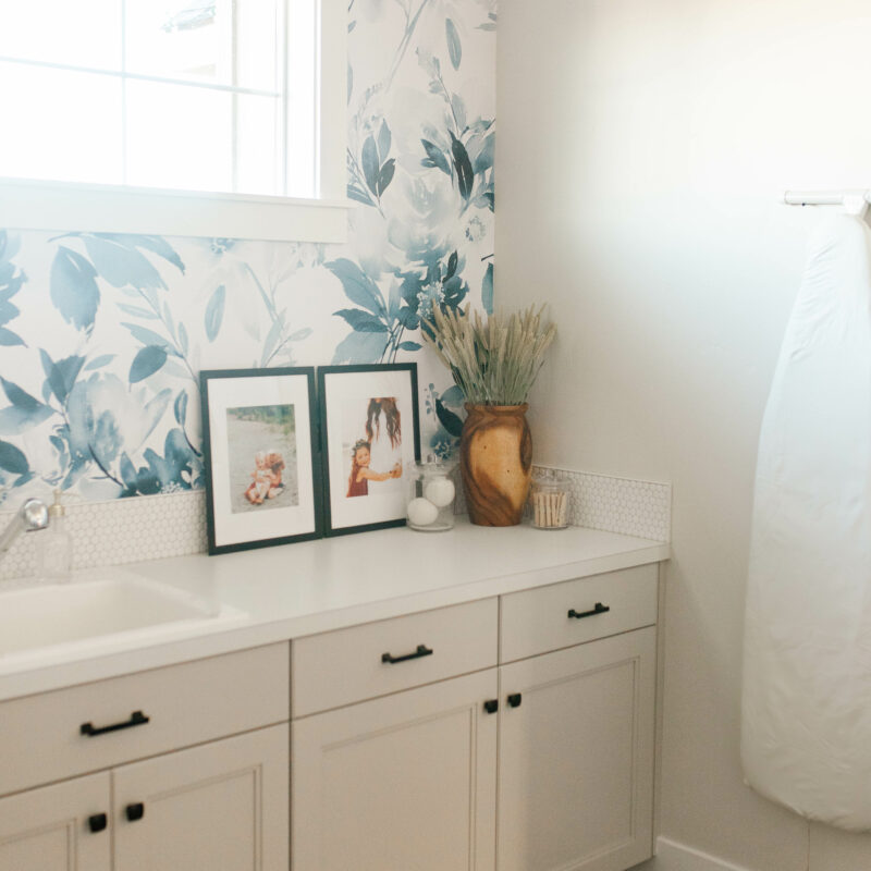 laundry room inspiration jess oakes / modern floral wallpaper greige and white counters laundry room with storage and large / big laundry room home decor modern farmhouse with samsung appliances